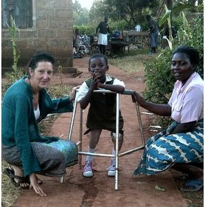 An inspiring story: Christine Gibbard, pictured in Kenya with Sharon, a little girl who needed an operation before getting prosthetic legs. Sharon has done well and can now walk.